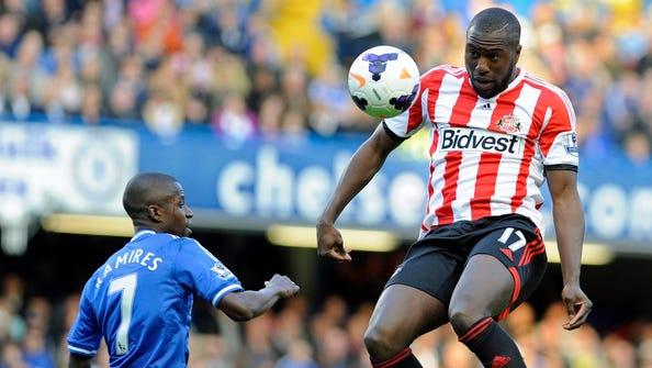 Sunderland's Jozy Altidore, right, vies for the ball with Chelsea's Ramires during the English Premier League soccer match at Stamford Bridge in London.