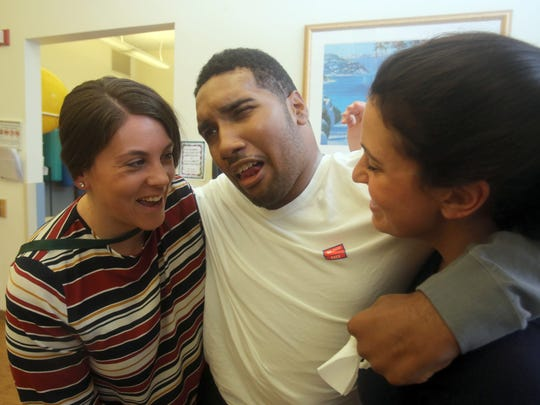 Jyrel Daniel, 22, of New Rochelle, works with physical therapists Bridget Mulroy and Danielle DiCarlo during a physical therapy session at Burke Rehabilitation Hospital in White Plains Dec. 15, 2017. Daniel was left in a near vegetative state after being involved in a car accident in 2016. He can now stand with the support of others, hold a fork, and feed himself finger foods.
