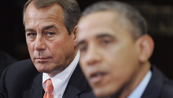 Boehner listens as President Obama speaks during a meeting with bipartisan group of congressional leaders in the Roosevelt Room of the White House on November 16, 2012.