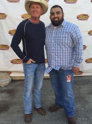 Aaron Aguirre with Kevin Fowler at a Meet and Greet at Concrete Street back in March of this year