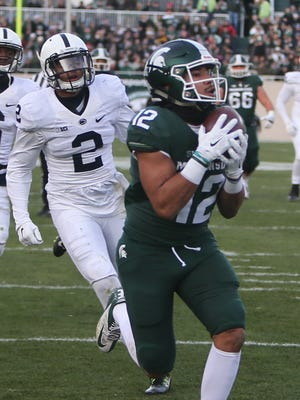 Michigan State WR R.J. Shelton catches a touchdown against Penn State's Marcus Allen during the first half Saturday.