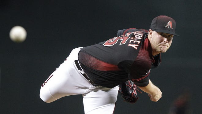 The Arizona Diamondbacks' Archie Bradley (25) pitches against the Los Angeles Dodgers at Chase Field on July 16, 2016.
