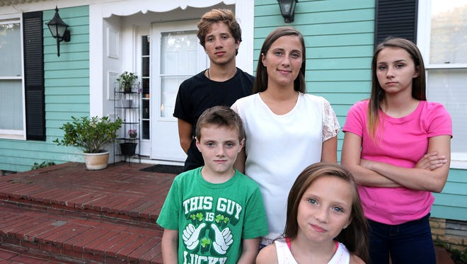 Carrie Nave and her 4 kids have been helped through Journey Home to pay her rent so she can attend school. The group is photographed on the front porch of their home Thursday, Sept. 8, 2016. (Front Row L to R) Micheal Nave, 9, and Emily Nave, 10. (Back Row L to R) Mckale Riley, 14, Carrie Nave, and Savana Nave, 13.