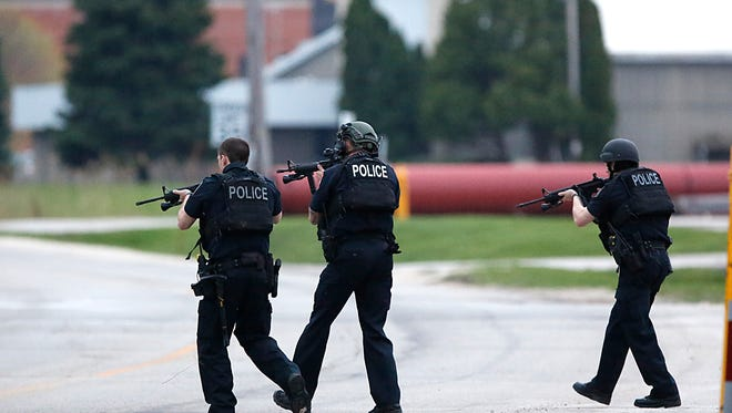 City of Fond du Lac police approach a person involved in a domestic dispute on Morris Street north of Pioneer Street April 26, 2017.