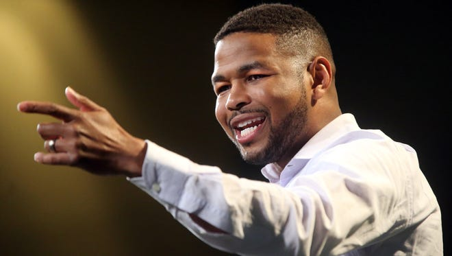 Former Tennessee football player Inky Johnson speaks about overcoming adversity during the 28th annual Stake & Burger event benefiting the Boys & Girls Clubs of Rutherford County in 2015.