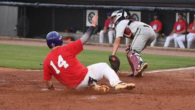 West Carroll's Colton Johnson slides safely through home plate as Crockett County's Hayden Love looks for the ball during the 2018 Bill Schrivner West Tennessee High School All-Star Game, Thursday, May 31.