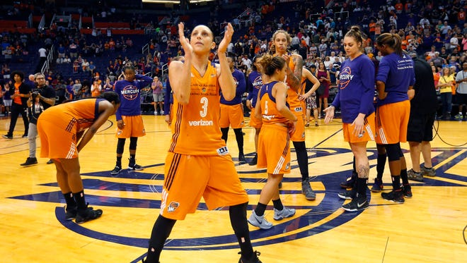 Phoenix Mercury guard Diana Taurasi (3) claps for fans after the Mercury were eliminated by the Los Angeles Sparks in the WNBA playoff semifinals at Talking Stick Resort Arena in Phoenix, Ariz.