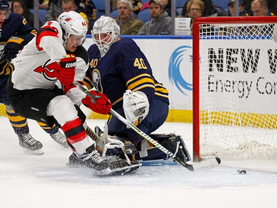 New Jersey Devils forward Miles Wood (44) puts the