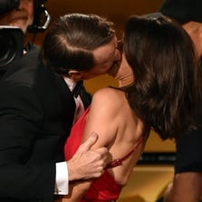 Bryan Cranston plants a kiss on  Julia Louis-Dreyfus as she approached the stage to get the Best Actress in a Comedy Emmy.