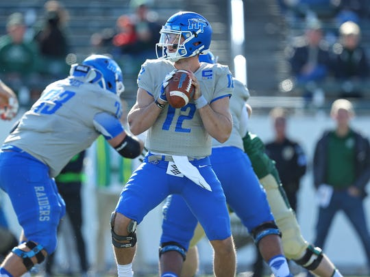MTSU quarterback Brent Stockstill looks downfield during a game against Charlotte at Jerry Richardson Stadium on Nov. 11, 2017. Stockstill threw for 255 yards in MTSU's 35-21 win, becoming the program's all-time leader in passing yardage.