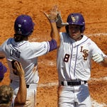 LSU's Mark Laird (9) and his teammates are comfortable with Aaron Nola pitching Saturday.