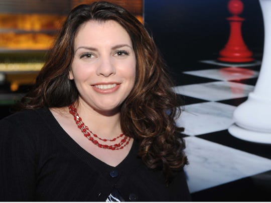 Stephenie Meyer poses on stage at the Breaking Dawn