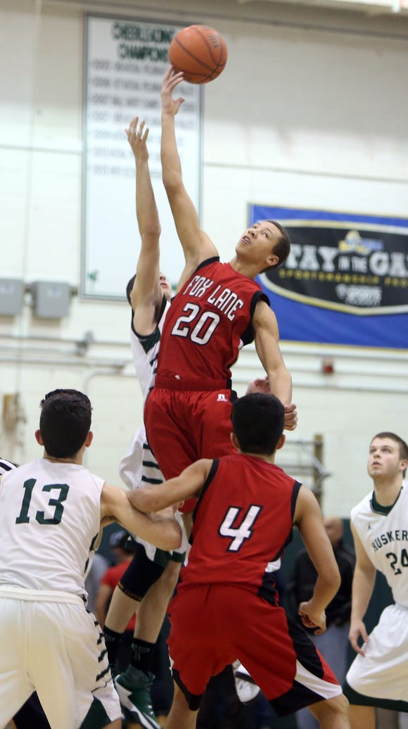Fox Lane's Josh Olsen (20) controls the opening tipoff