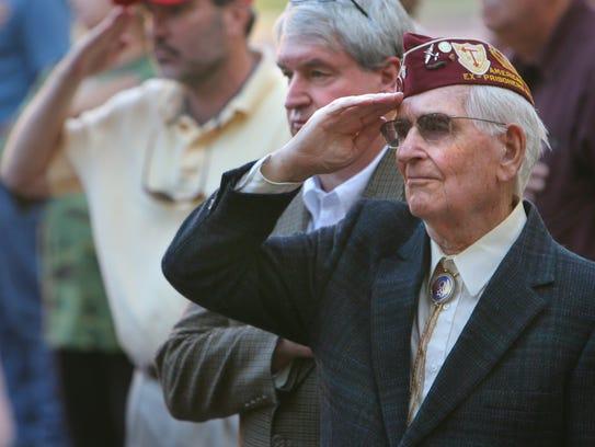 Carey Jones, Sr., right, salutes near his son Carey,