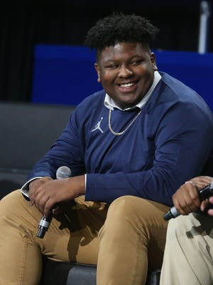 Michigan recruit Cesar Ruiz answers questions for fans during the Signing of the Stars event at the Crisler Center in Ann Arbor on Wednesday, Feb. 1, 2017.