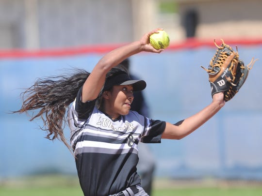 Lubbock High pitcher Moriah Garza throws a pitch in the third inning against Cooper. Garza tossed a four-hitter in the Lady Westerners' 15-4 victory over the Lady Cougars in five innings in the District 4-5A softball game Saturday, April 14, 2018 at Cougar Diamond.