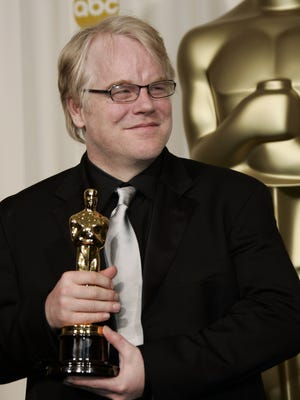 """Actor Philip Seymour Hoffman poses with the Oscar he won for best actor for his work in """"Capote"""" at the 78th Academy Awards Sunday, March 5, 2006, in Los Angeles."""