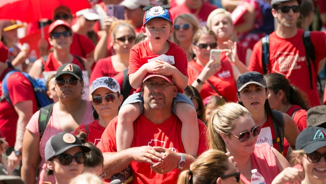 """Kids, parents and teachers, at a """"Red For Ed"""" rally at the Arizona capitol in Phoenix on the second  day of the Arizona teacher walkout on Friday, April 27, 2018."""