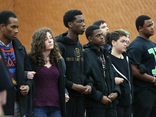 University of Wisconsin-Madison student demonstrators join together as they protest racism on campus during a meeting for the UW System Board of Regents on campus in Madison on Friday.