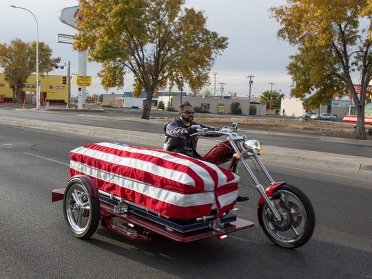 The casket of fallen retired police officer J.R. Stewart