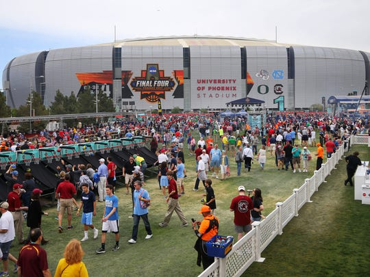 Fans hang out during the NCAA Tip-Off Tailgate outside