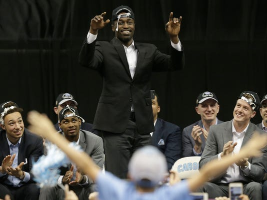 Theo Pinson reacts as North Carolina basketball players and coaches greet fans in Chapel Hill, N.C., Tuesday, April 4, 2017 following Monday's win over Gonzaga in the NCAA college basketball championship. (AP Photo/Gerry Broome)