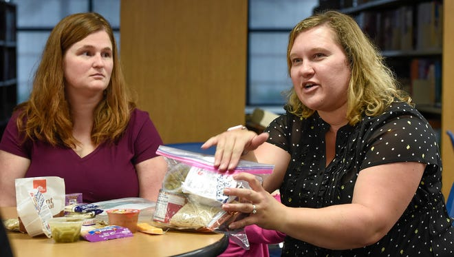 Organizers Helen Schommer and Suzanne Friedrich talk about their program to help feed student on weekends and during breaks Friday, Sept. 1 at Discovery School in Waite Park.