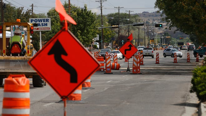Road construction continues Wednesday on East 20th Street in Farmington. The street is one of several in the city that officials have targeted for construction projects that will promote safety for pedestrians and bicyclists.