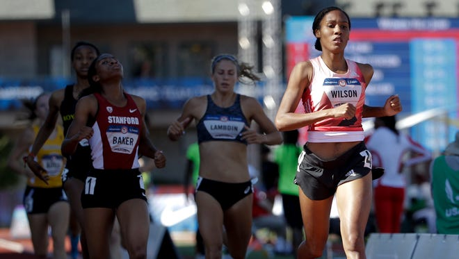 Ajee' Wilson, right, wins heat three during qualifying for women's 800-meter run at the U.S. Olympic Track and Field Trials, Friday, July 1, 2016, in Eugene Ore. (AP Photo/Marcio Jose Sanchez)