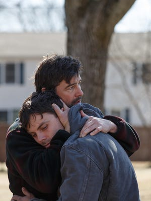 Kyle Chandler (back) and Casey Affleck play brothers in a family haunted by tragedy in 'Manchester by the Sea.'