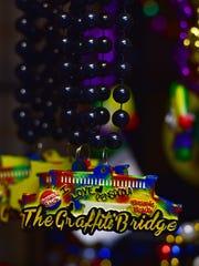Mardi Gras beads featuring Pensacola landmarks at Pensacola Mardi Gras People.