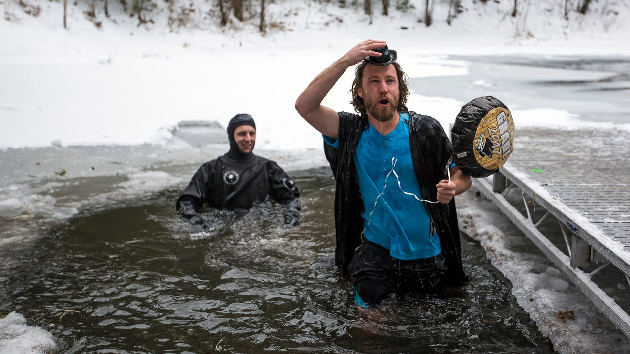 Over a dozen Stevens Point area educators participated in the Polar Pond Plunge at Boston School Forest in Plover, Wis., Saturday, December 16, 2017. The event raised more than $10,400 to build a handicap accessible bridge over Ellingboe Pond.