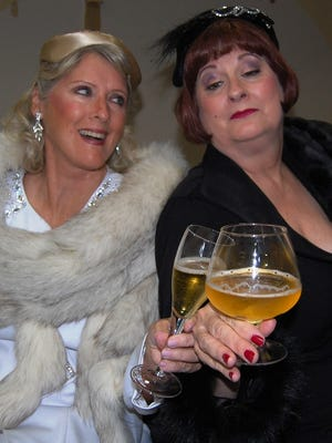 Mame Dennis (Patty Ward) and her bosom buddy Vera Charles (Sue Chekaway) toast to their old, old, old friendship.