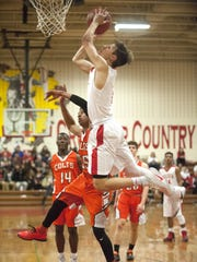 Delsea's Brice Parks shoots above Cumberland's Shaun