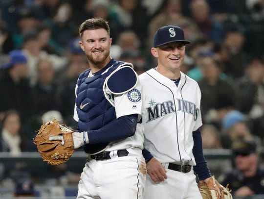 Seattle Mariners catcher Mike Marjama, left, and third