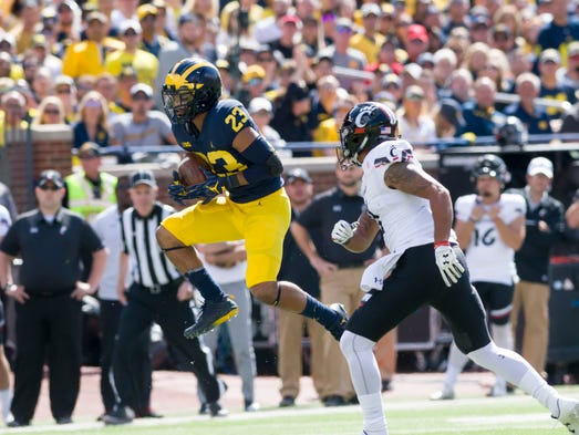 Michigan defensive back Tyree Kinnel intercepts a ball