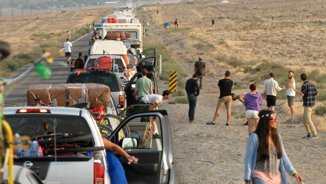 Burning Man traffic is backed up on Highway 447 on Aug. 26, 2013. People waited upwards of eight hours once they got to the playa to enter the yearly event near Gerlach, Nevada.