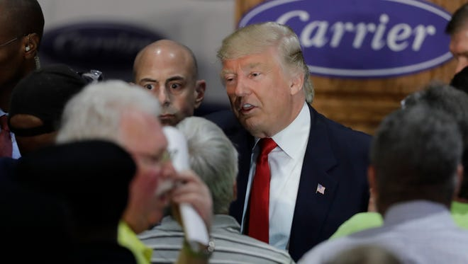 President-elect Donald Trump talks with workers at Carrier Corp Thursday, Dec. 1, 2016, in Indianapolis.