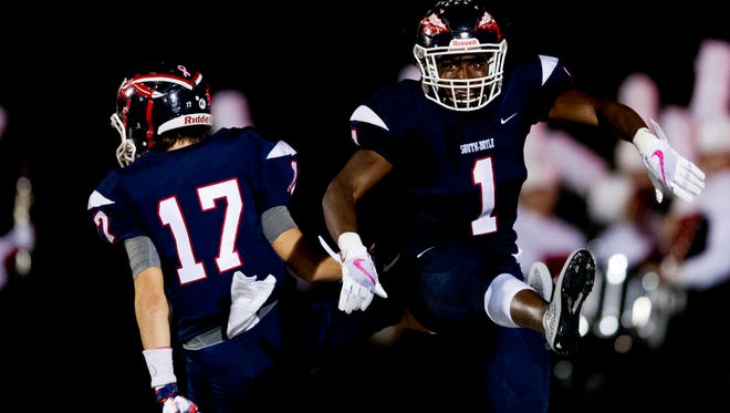 South Doyle's Ton'Quez Ball (1) and Austin Shuler (17) celebrate after Ball's touchdown South Doyle's during a game between South Doyle and Halls at South Doyle High School in Knoxville, Tennessee, on Friday, October 6, 2017.