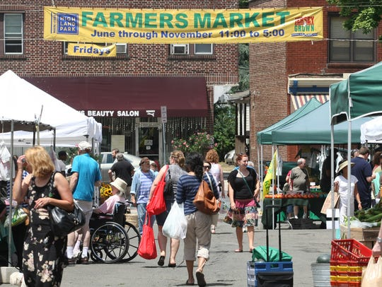 Shoppers peruse the Highland Park Farmers Market.