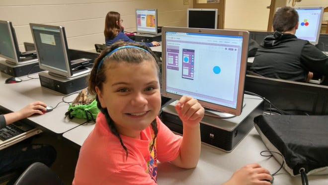 Kylee Wood, a sixth grade student at Bessie Allen Middle School, learns computer coding through a one-hour tutorial offered through Hour of Code.