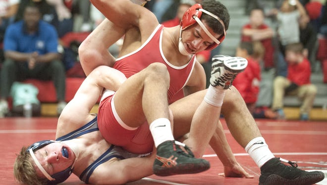 Paulsboro's Joey Perez, top, works to take control of Collingswood's Will West during their 138-pound bout in Friday's Colonial Conference matchup. Perez won 14-5.