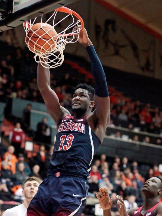 FILE - In this Feb. 22, 2018, file photo, Arizona's Deandre Ayton (13) gets behind the Oregon State defense for a dunk during the second half of an NCAA college basketball game in Corvallis, Ore. Ayton was selected to the AP All-Pac-12 team on Tuesday, March 6, 2018. (AP Photo/Timothy J. Gonzalez, File)