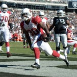 Andre Ellington #38 of the Arizona Cardinals runs with the ball against the Oakland Raiders in the second half at O.co Coliseum on October 19, 2014 in Oakland, California.