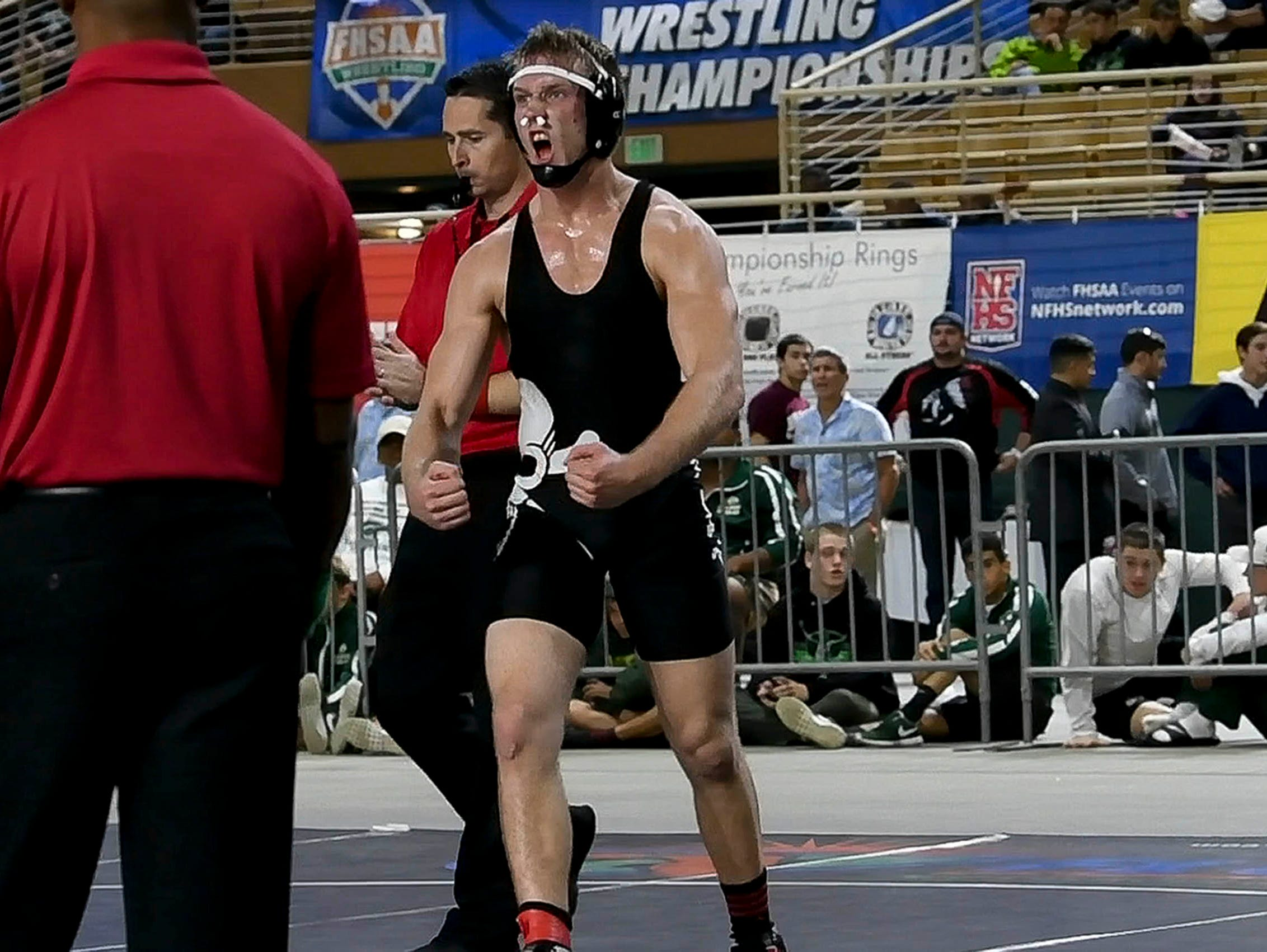 Matt Cates of Palm Bay defeats Natorian Lee of Orange Park for the state wrestling title at 170 pounds at the Class 2A state finals in Kissimmee.