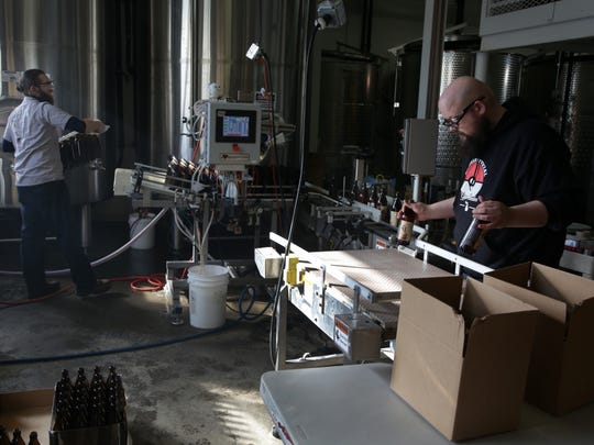 Stephen Krupitzer, left and Brent Burgess bottle and package mead at the B Nektar facilities in Ferndale.