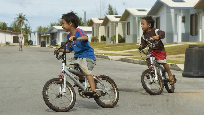 In this file photo, children play in the streets at Ironwood Estates in Dededo. With summer break beginning soon, it's important for everyone to take steps to keep children safe while they're out of school.