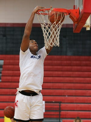 Aspire Academy's Charles Bassey (23) dunked during warmups before their game against Orangeville Prep at Seneca High School.  