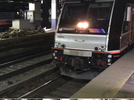 An NJ Transit train pulls into Penn Station in New