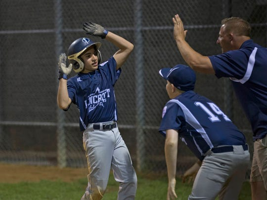 Josh Szitanko celebrates with his team after scoring on a triple and a misplay at third base. Lincroft vs  Manalapan in District 19 Little League tournament in Eatontown, NJ on July 6, 2017.